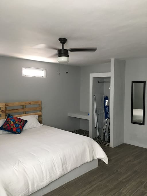 Bedroom with a comfortable king size bed, ceiling fan, spacious closet and air conditioner
