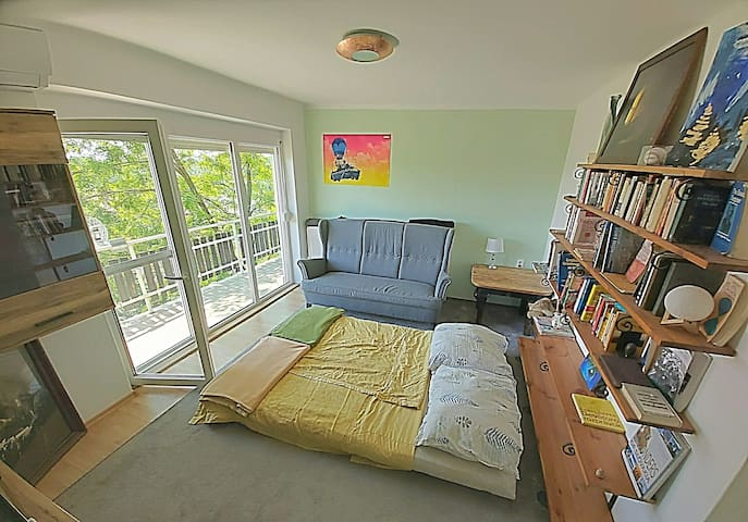 This is the room upstairs the bed is a futon but folds out into a full bed with regular mattress comfortable for two people