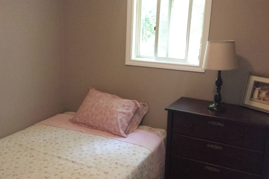 bright Bedroom with new double, pillow top mattress.
