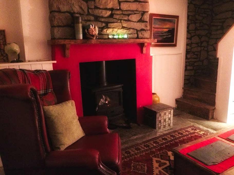 Sit by the fire in the cosy living room!