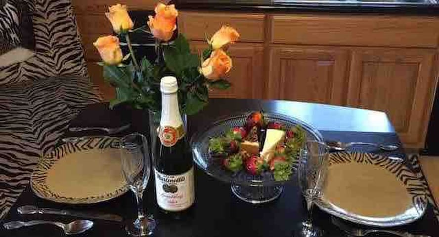 Add a romantic package to your stay! Customize a package with cheesecake, fresh flowers, customized glasses, strawberries with chocolate dip and petals on the bed. *Extra fee will apply. Contact me for details!