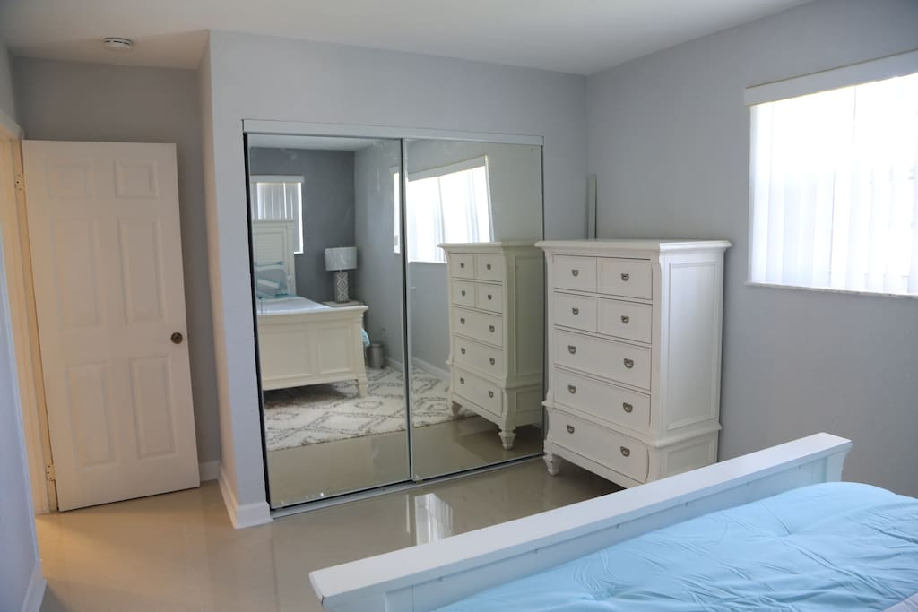 Full closet with full mirror and dresser for your personal use.