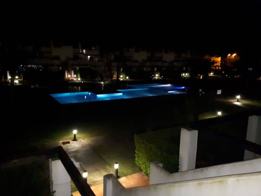 Swimming pool lit at night