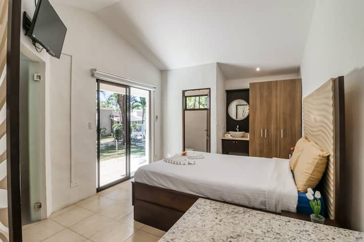Sophisticated Ground Floor Studio with Shared Pool, WiFi, and Partial AC