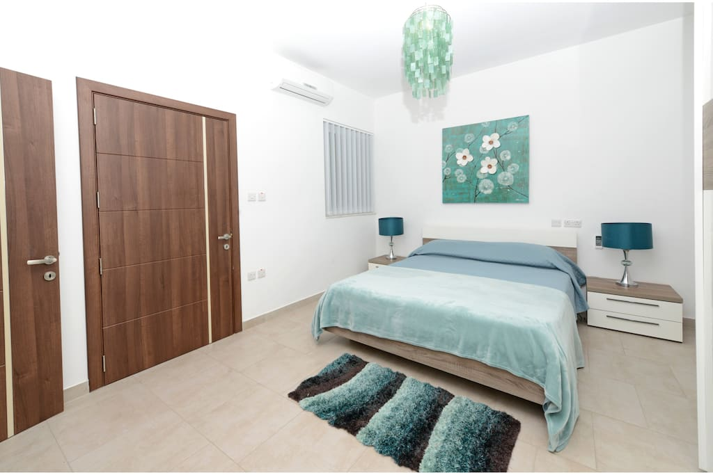 Main Bedroom with a King Size Bed, AC unit and en-suite