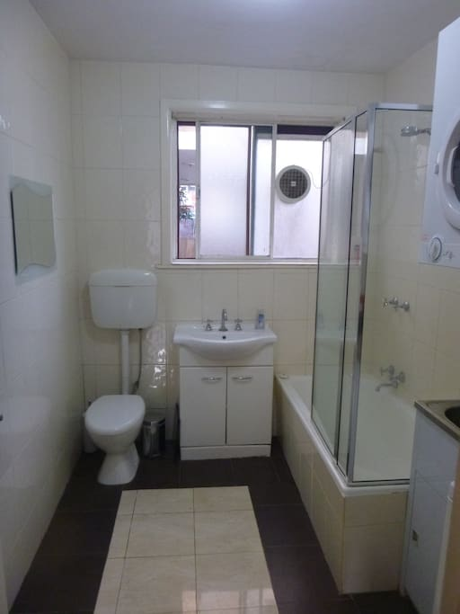 Bathroom with shower, bath, washer and dryer