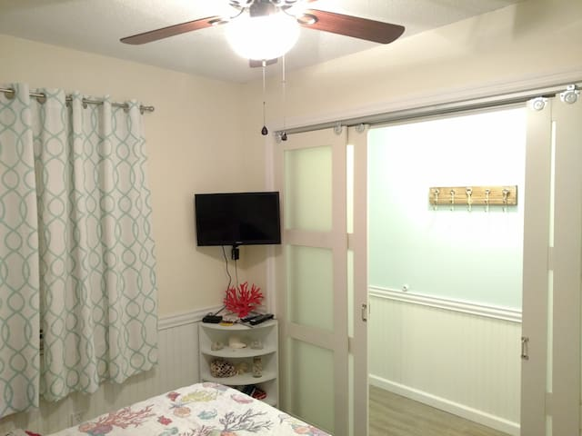 Private master bedroom and HDTV