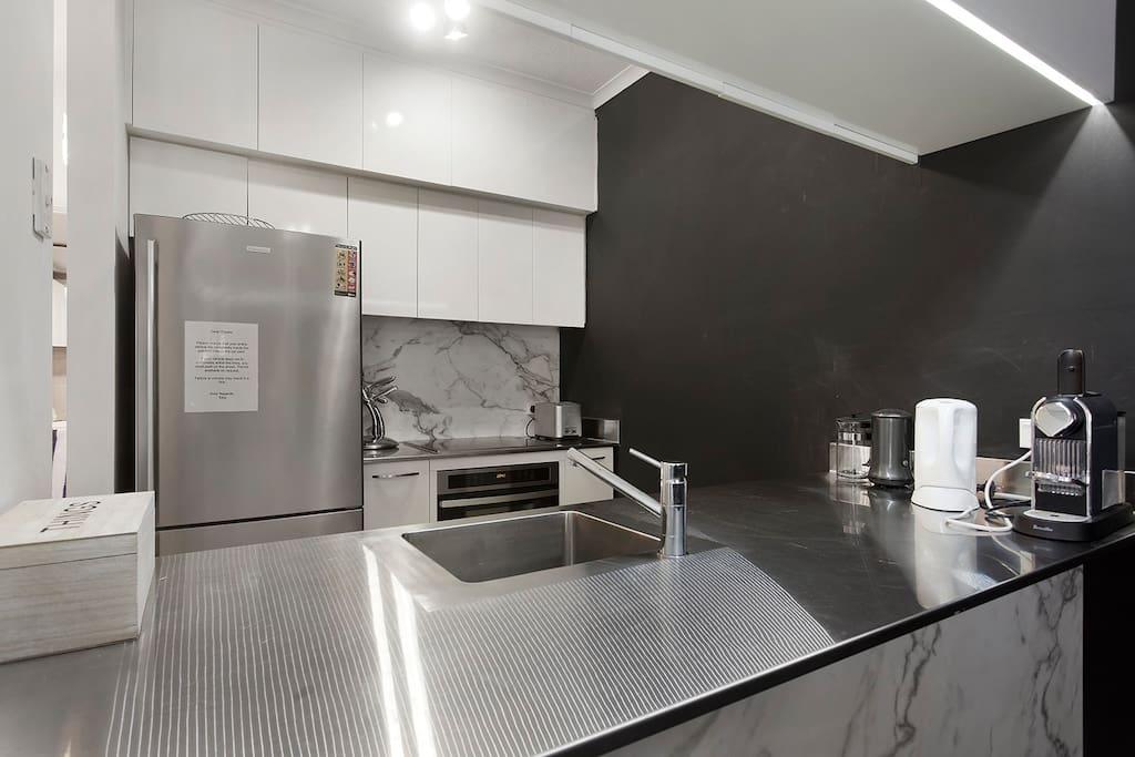 ultra modern steel kitchen with dishwasher
