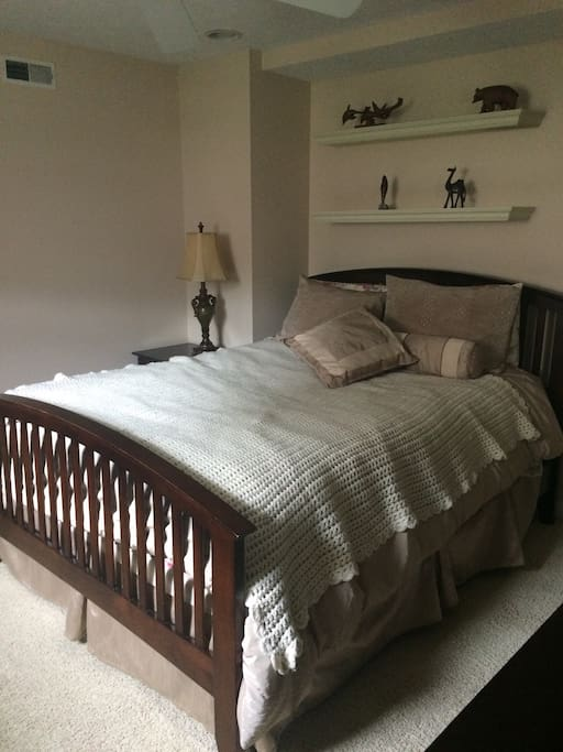 A queen size bed with plenty of lighting. A closet is available to hang up clothes and store your luggage.