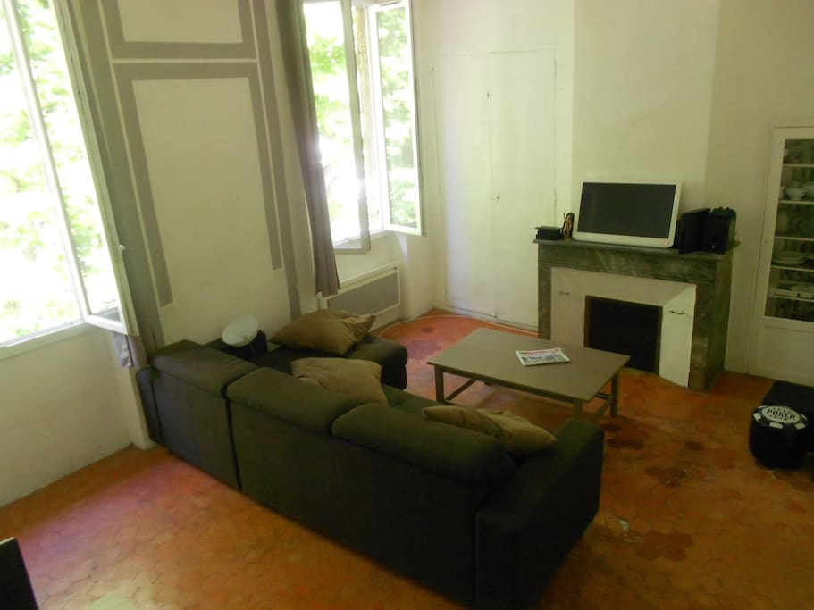 A living-room with convertible sofa bed, TV, WiFi, Radio
