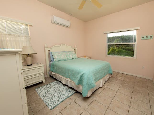 Second bedroom with garden and bluff view.