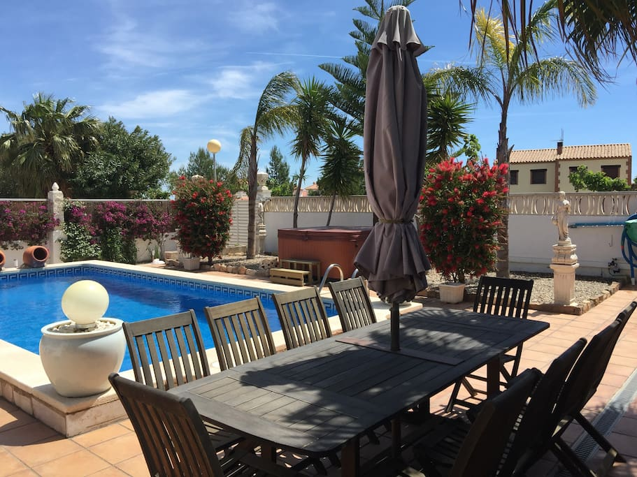 Outdoor dining for 10 alongside private 8x4m pool and hot tub