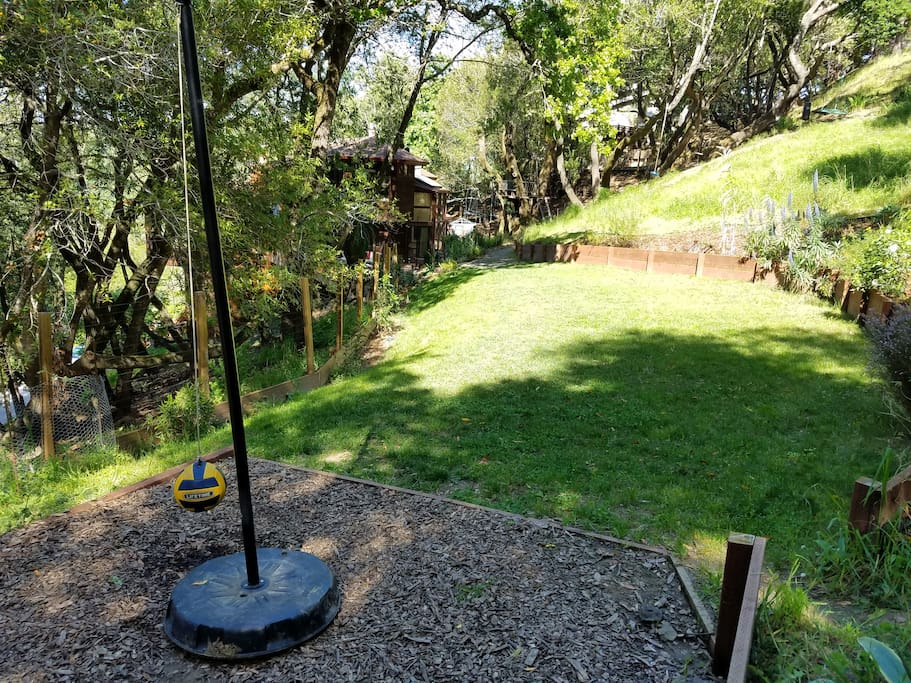 Tether Ball court with view of sunny yard towards house