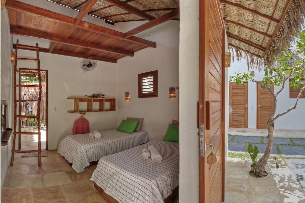 One of the bungalows with possibility of double queens bed or 2-3 single beds, the mezanine can be a great spot for a 3rd person or a child ... accessible by the ladder.