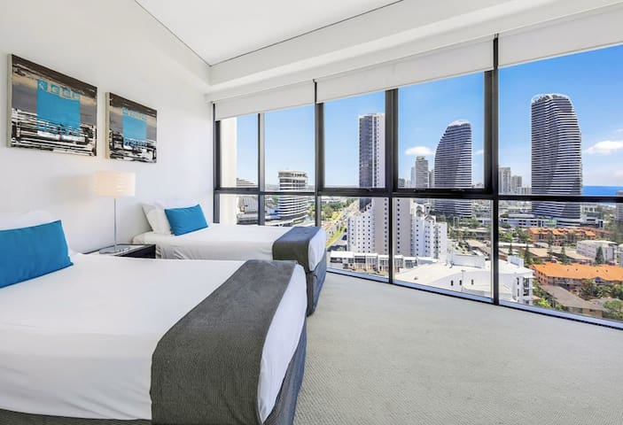 Second bedroom with 2 single beds - views to the ocean