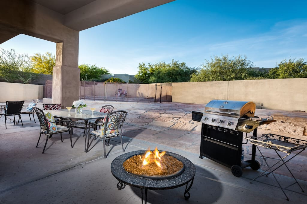 Outdoor patio with BBQ gas grill and fire pit