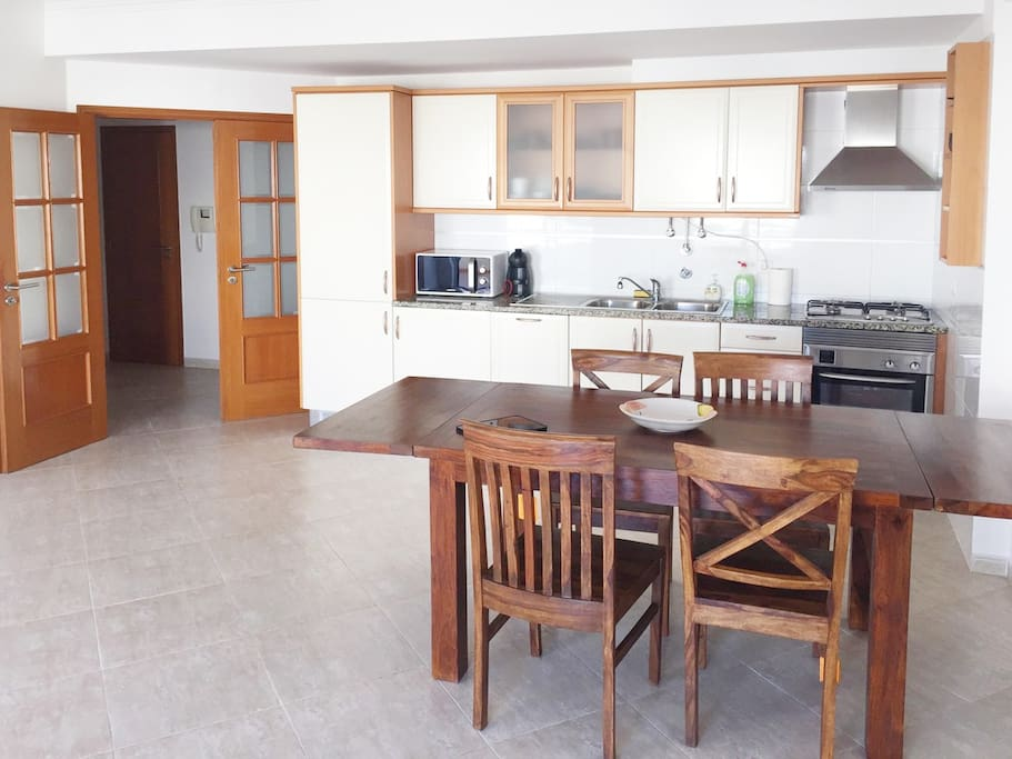 Fully equipped kitchen with washing machine, dishwasher, oven, toaster, coffee machine, etc.