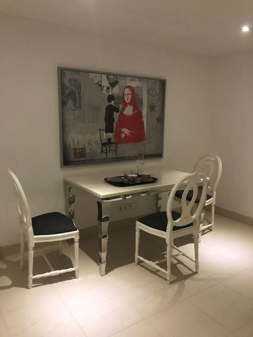 Table and chairs for enjoying coffee etc in studio.