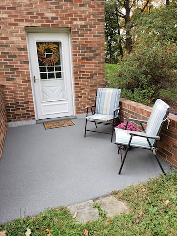 The private entrance offers a cozy porch for guests to relax and enjoy the privacy and solitude of the great outdoors.