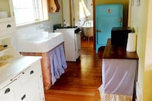 Vintage kitchen all around, even down to the dishes.