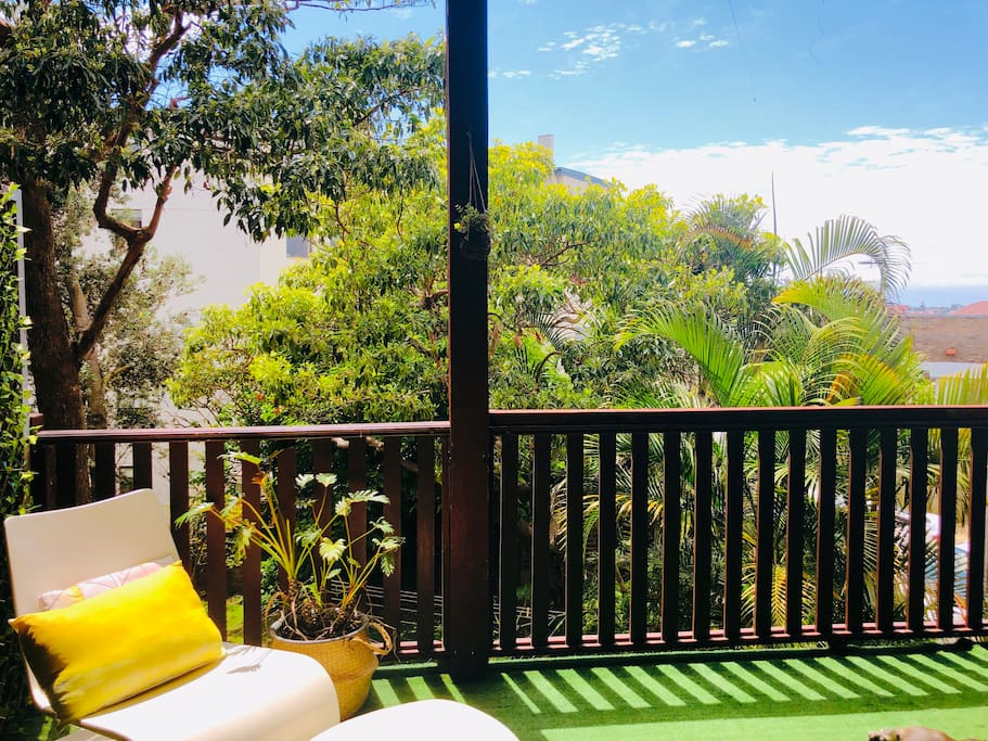 Leafy sun filled balcony with ocean breezes. Perfect for afternoon drinks and morning coffees