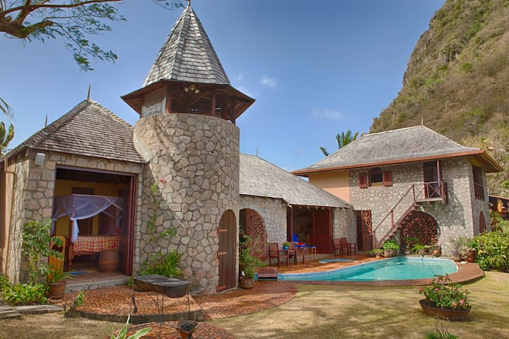 Villa Piton in morning light illustrates its proud position next to the Gros Piton! One of very few homes within the World Heritage Site. Its prominent ridge top location provides constant air ventilation!
