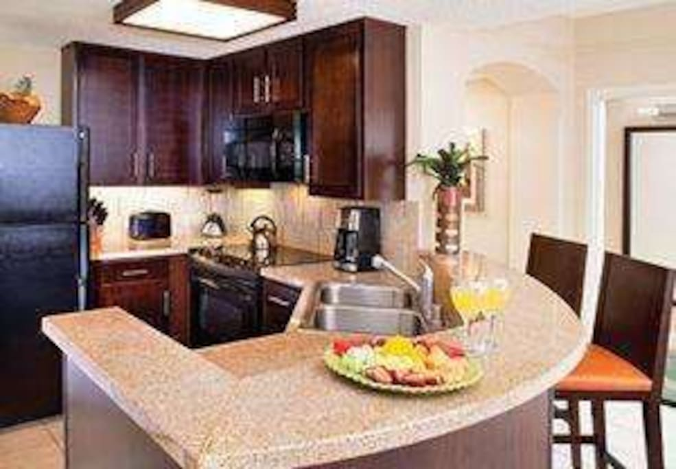 Conveniently located fully equipped kitchen to prepare meals or snacks