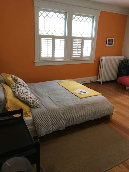 Queen bed in spacious light filled room