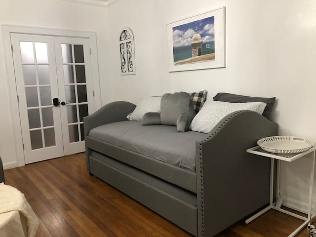 Twin day bed with Trundle on wheels under. Under also a Twin mattress