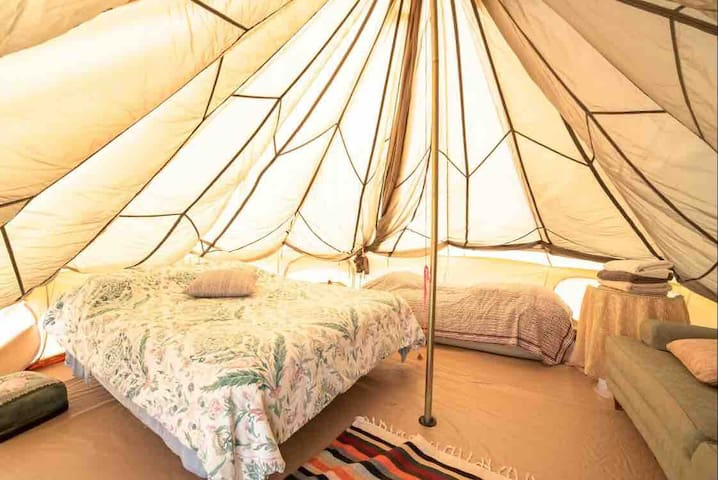 The green tent , can accommodate up to 4 guest: bed layout:  1queen size 1 twin size 1 sofa