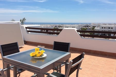 Nuestra Casa, apartment with roof terrace and shared swimming pool