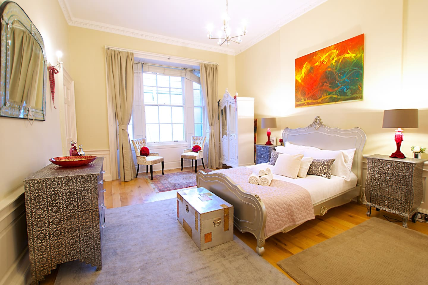 The master bedroom with a large comfy bed to sink into