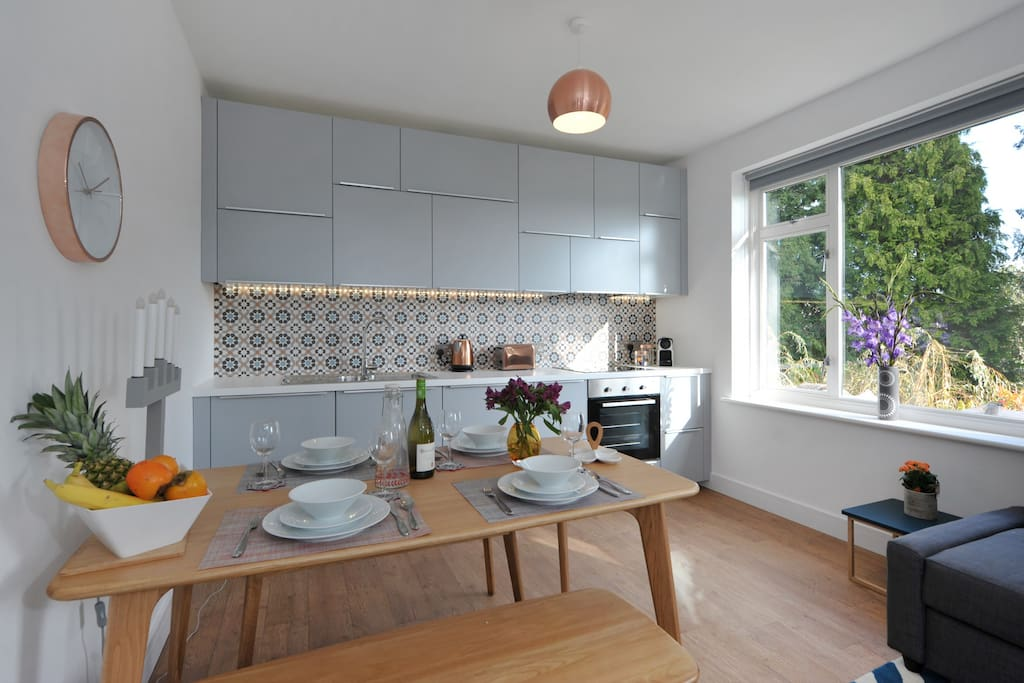 Light open plan kitchen-diner at the back with stunning views across to Bathford village