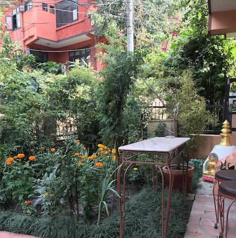 Little garden with  Buddhist stupa and Hindu Shrine
