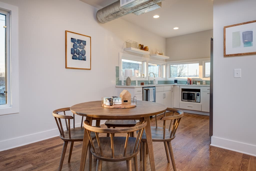 Gather at the 4-person dining table for home-cooked meals in Unit 1.