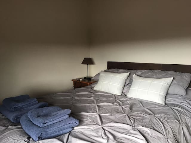 2nd Bedroom, downstairs. king size bed, Sky Q TV. View over fields to front of cottage