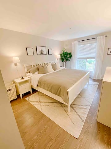 """Primary Bedroom with King Bed , 42"""" Smart TV, Access to patio , 2 closets, 8 drawer dresser and Full Ensuite Bathroom"""