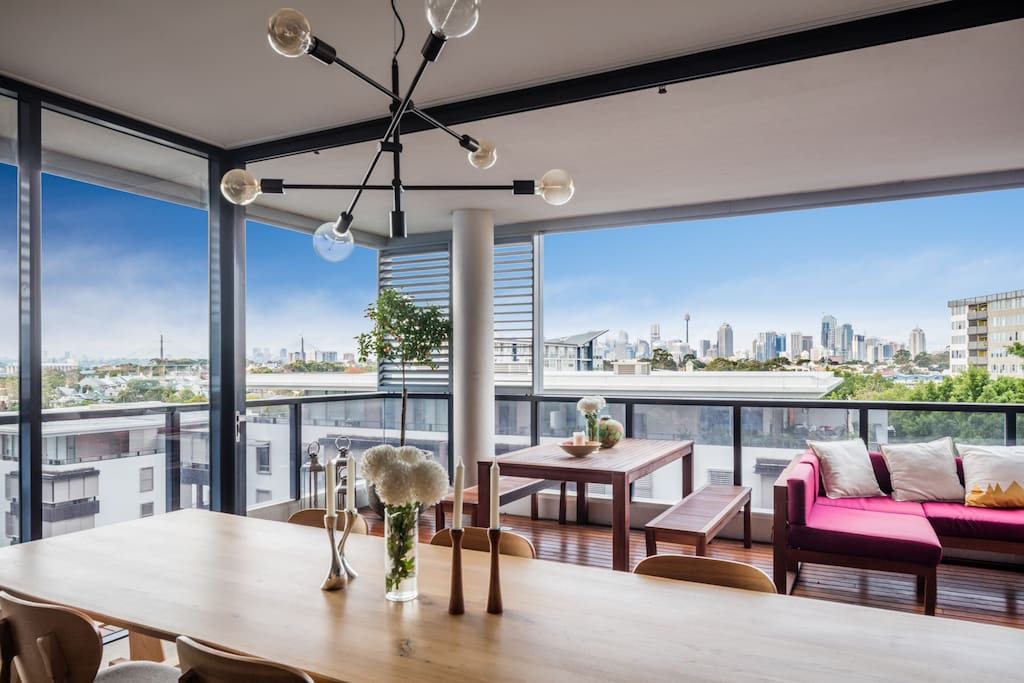 Views of the Anzac bridge, CBD and University of Sydney, from the 3-metre American oak dining table