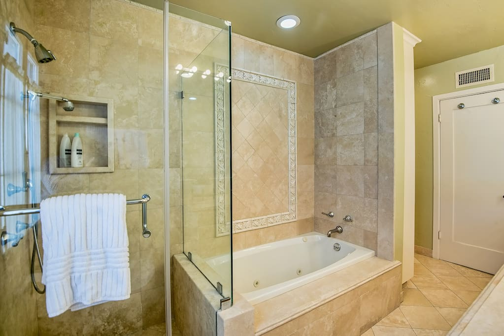 Shower and jacuzzi tub in private bathroom