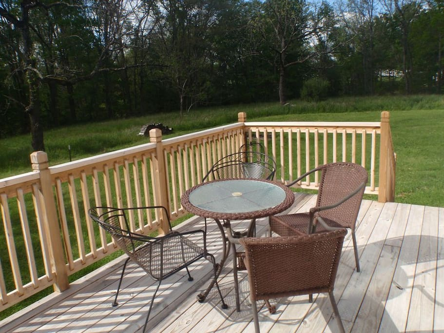 Just off of the kitchen is our cozy deck. It's the perfect place  to enjoy coffee in the mornings, star gaze  after dark, or just to unwind, any time. ❤