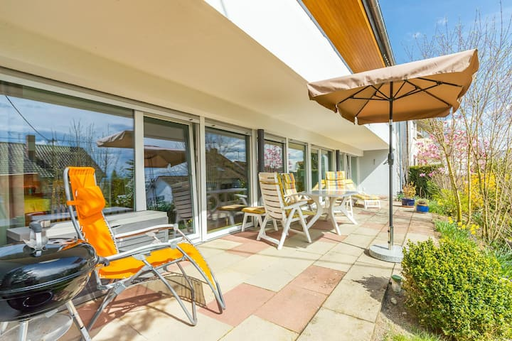 Modern Holiday Apartment with Garden Terrace and Wi-Fi; Parking Available