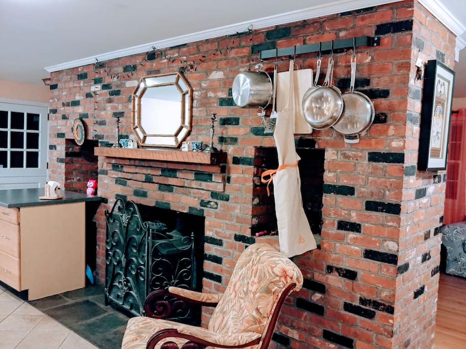 Fireplace in kitchen with woodstove/fireplace.