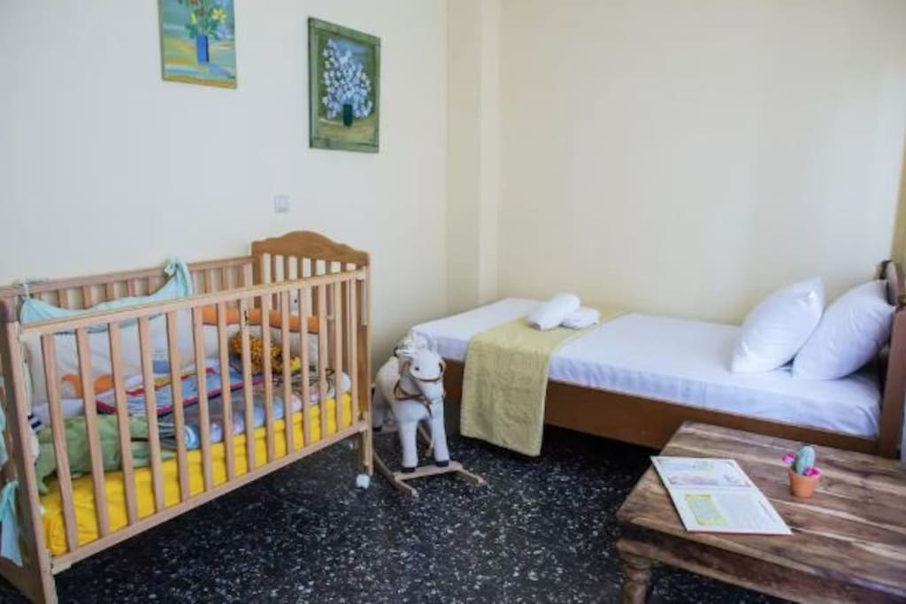 2nd Bedroom with one single bed and baby cot