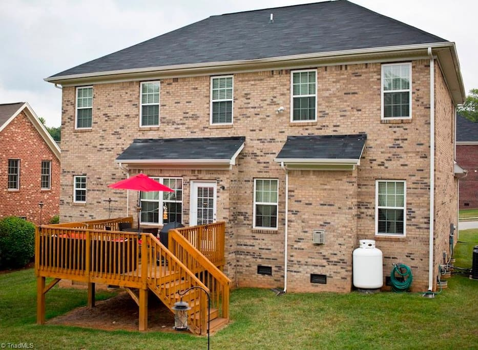 Back yard and porch with grill and umbrella