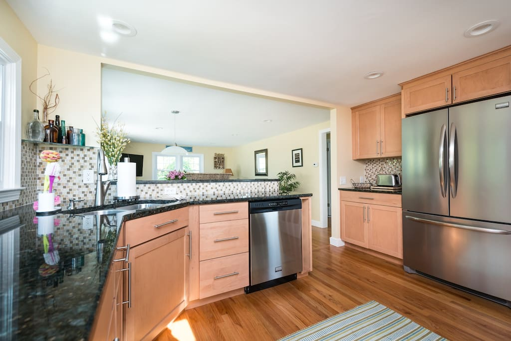 bright kitchen with all stainless amenities and granite counters