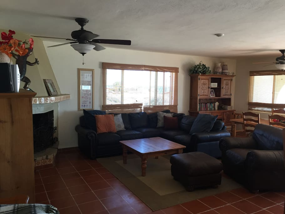Large open space living room with fireplace and dining room with large table seating 6.