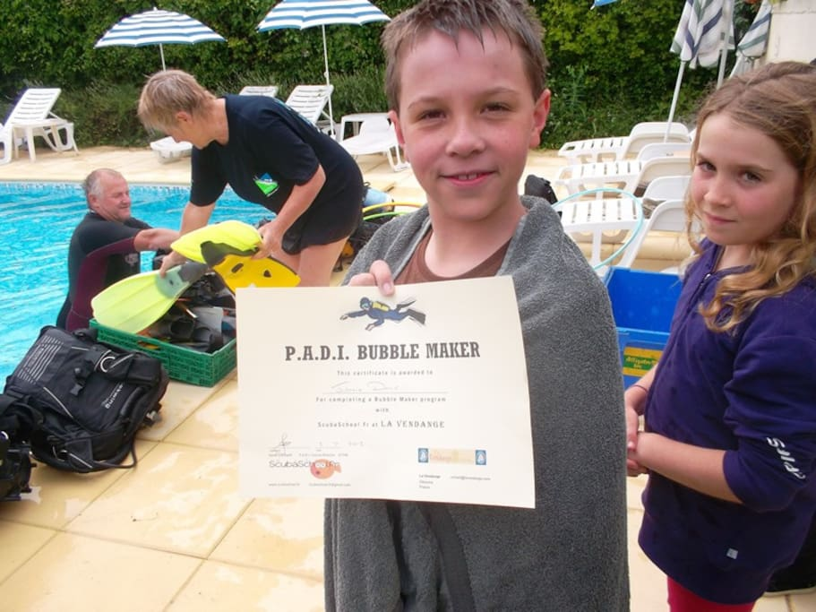 Jamie with his PADI diving certificate