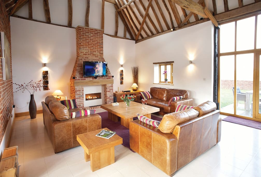 Ground floor:  Spacious vaulted sitting room with dining area leading to open plan kitchen