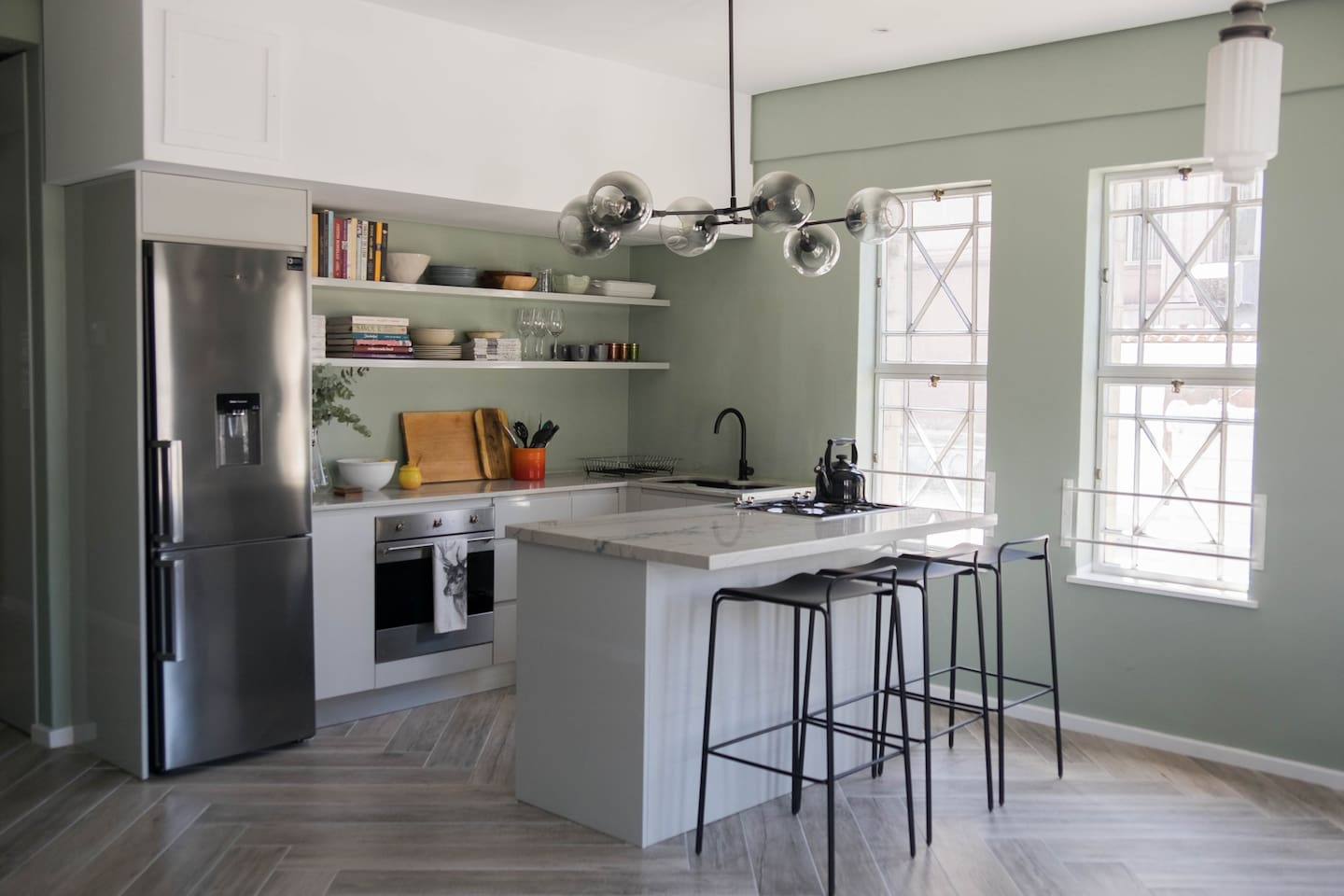 The galley kitchen, with its large island is perfect for cooking, entertaining or just hanging out after a day spent exploring Cape Town