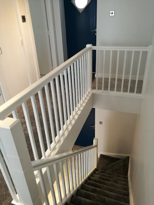 Stairs leading to the bedrooms and bathroom